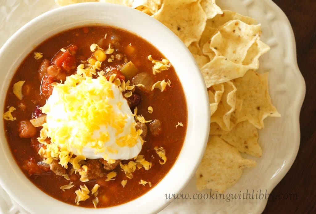This easy recipe for Slow Cooker Taco Soup can be made with beef or chicken. It's a taste of the south west made in your slow cooker. Top each serving with a dollop of sour cream and shredded cheddar cheese. #easyrecipes #slowcookerrecipes #slowcookersoup #tacosoup #mexicanrecipes