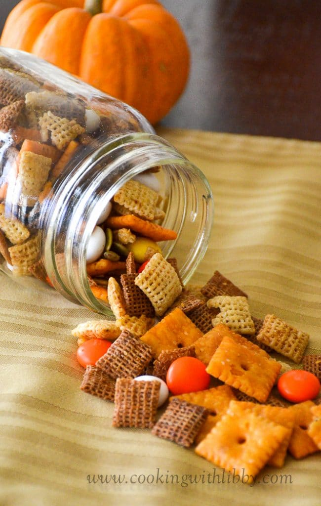 Fall Harvest Chex Mix spilling out of a mason jar.