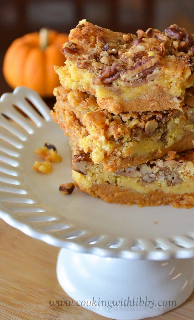 This super easy recipe for Pumpkin Pecan Crunch Bars uses a yellow cake mix combined with pumpkin and other autumn spices. Spice up your collection of fall treats or place them on the Thanksgiving menu! You won't regret it! #fallrecipes #baking #desserts #dessertrecipes #pumpkin #dessertfoodrecipes #Thankgivingrecipe