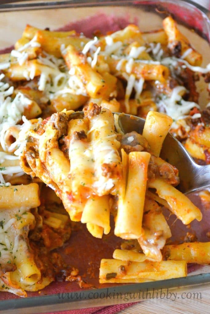 Spoonful of 5 Ingredient Baked Ziti from a casserole dish.