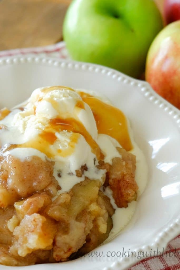 Cinnamon Apple Crisp topped with vanilla ice cream and caramel.