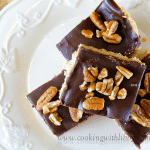 These No Bake Chocolate Peanut Butter Bars resemble Buckeye Candy, except they are in bar form. Assembly is simple and they do not require baking.