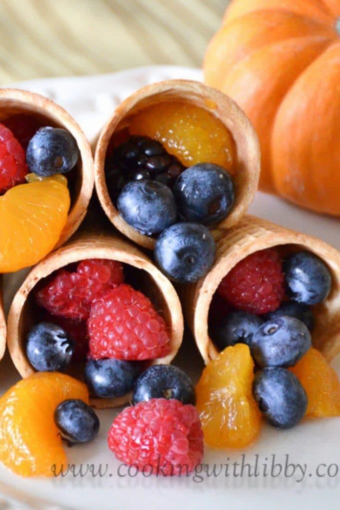 Fruit Cornucopias with pumpkin on plate